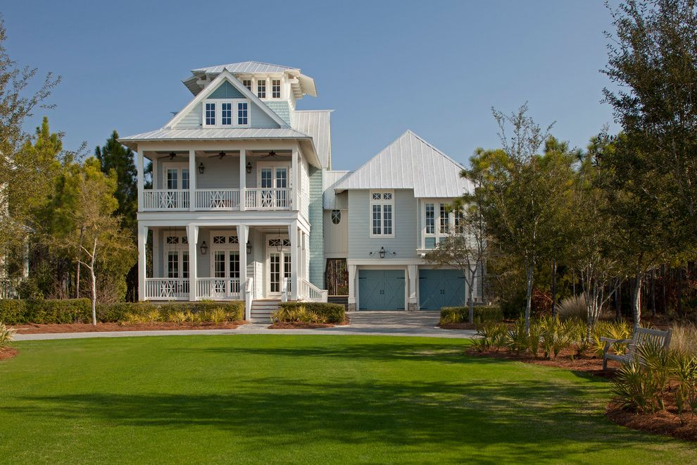 Colors on White Key West with Beach Style Exterior and Blue Exterior Blue Garage Door Blue Siding Grass Hanging Lantern Lawn Metal Roof Oversized Lawn Porch Single Garage Door White Porch Railing White Railing White Stair Railing White Trim