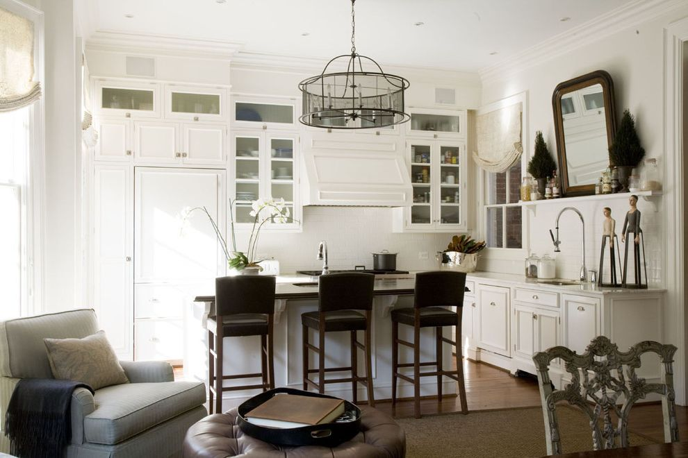 Colors on White Key West with Traditional Kitchen and Breakfast Bar Cabinet Front Refrigerator Drum Chandelier Eat in Kitchen Neutral Colors Open Kitchen Panel Refrigerator Range Hood Shade Chandelier White Kitchen