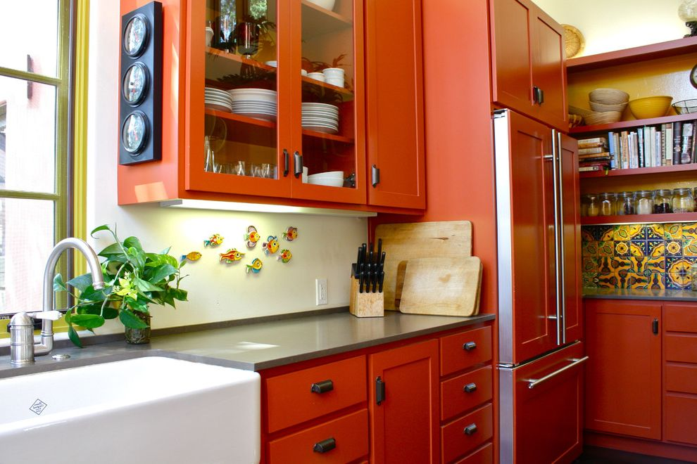 Coloured Fridges   Southwestern Kitchen  and Apron Sink Colorful Tile Drawer Pulls Farm Sink Glass Front Cabinets Gray Counters Integrated Kitchen Open Shelving Orange Cabinets Yellow Trimmed Windows