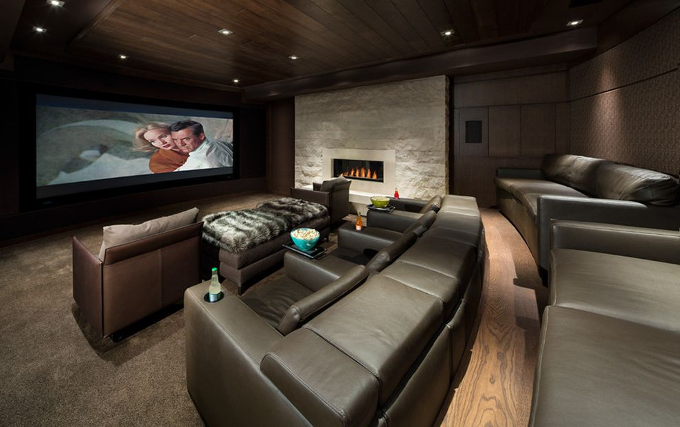 Columbia Sc Theaters   Contemporary Home Theater Also Fireplace High Ceilings Home Theatre Seating Leather Chairs Neutral Open Space Stairs Steel Stone Stone Accent Wall Stone Fireplae Timber