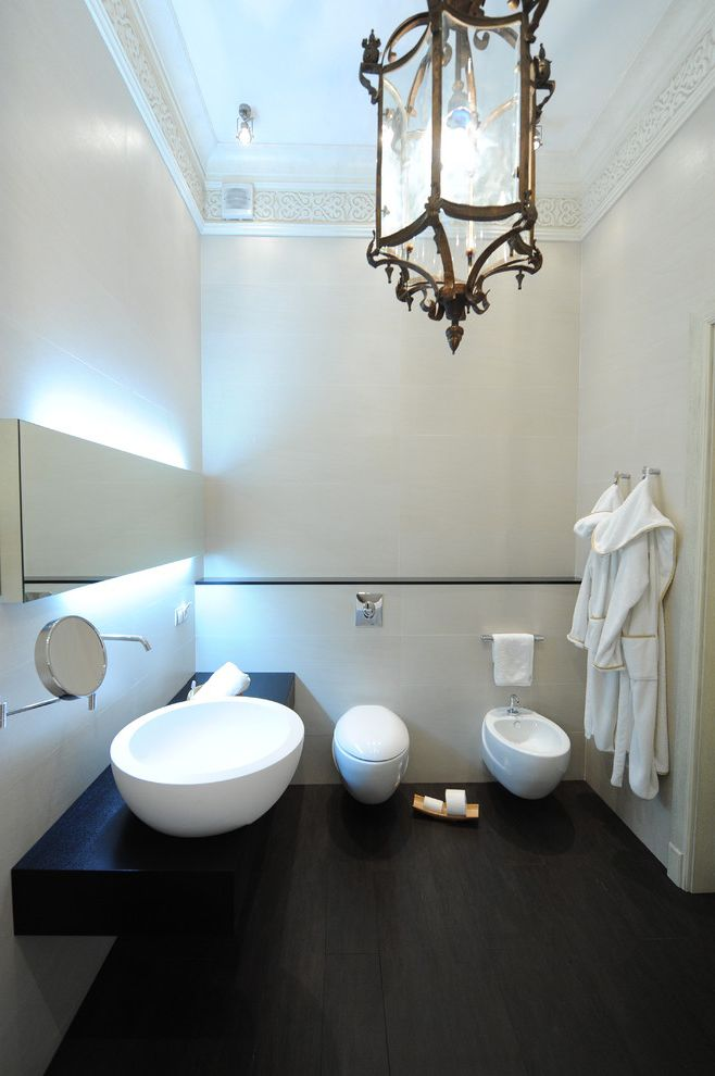 Commercial Grade Toilets with Contemporary Bathroom  and Backlighting Bathroom Mirror Bidet Cosmetics Mirror Crown Molding Dark Floor Floating Vanity Lantern Minimal Pendant Lighting Vessel Sink Wall Mount Faucet White Wood Wood Trim