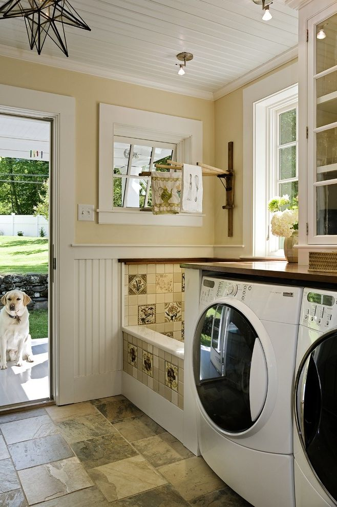 Commercial Grade Washing Machine   Traditional Laundry Room Also Back Door Bead Board Dog Wash Area Drying Rack Glass Front Cabinets Painted Wood Ceiling Star Pendant Tile Floor Washer and Dryer White Trim