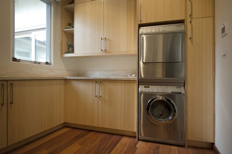 Compact Stackable Washer and Dryer   Contemporary Laundry Room Also Blonde Wood Built in Storage Front Load Washer and Dryer Open Shelves Stackable Washer and Dryer Stacked Washer and Dryer Wood Flooring