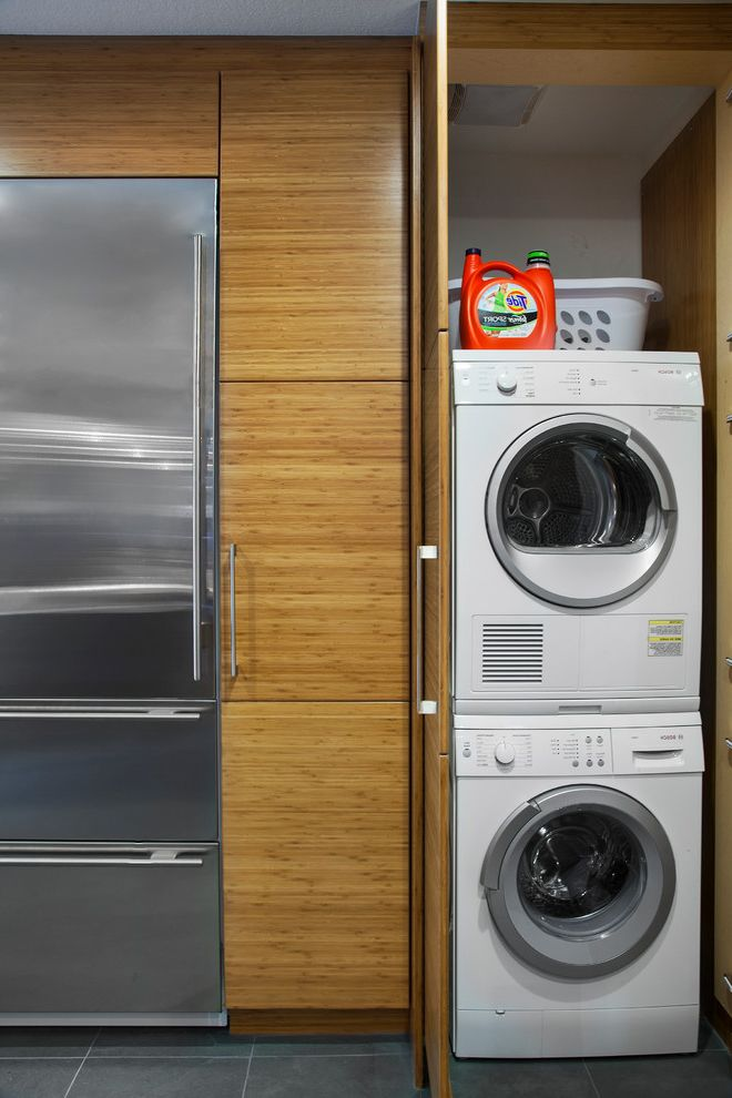 Compact Stackable Washer and Dryer   Modern Laundry Room  and Laundry Closet Slate Tile Stackable Washer and Dryer Utility Room for Small Spaces Washer and Dryer in Cabinet
