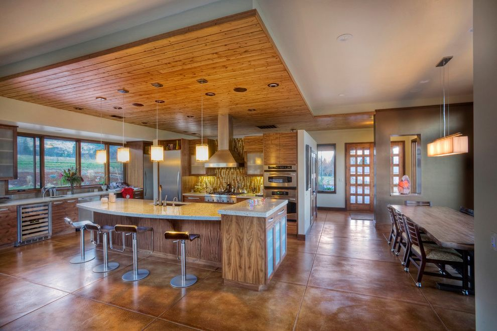 Concrete Staining Oc   Contemporary Kitchen Also Accent Ceiling Acid Stained Concrete Breakfast Bar Ceiling Treatment Concrete Floor Eat in Kitchen Island Lighting Kitchen Island Neutral Colors Open Kitchen Pendant Lighting Wood Cabinets Wood Paneling