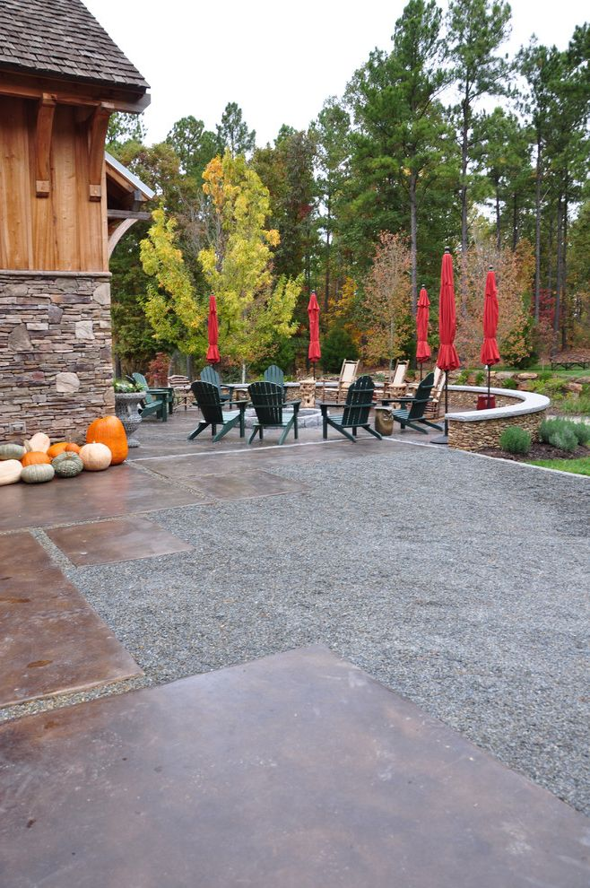 Concrete Staining Oc   Traditional Landscape Also Adirondack Chairs Barn Corbels Curved Garden Wall Fire Pit Gravel Landscaping Natural Wood Outdoor Seating Pumpkins Red Umbrella Shingle Roof Stacked Stone Foundation Stained Concrete