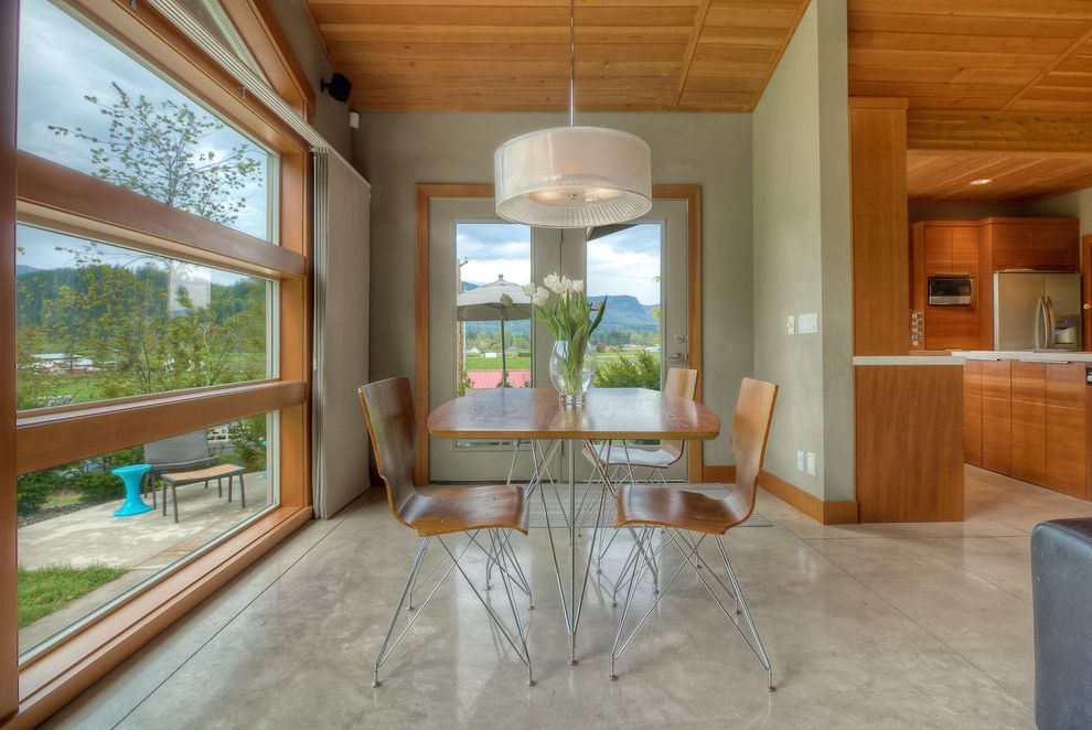 Concrete Staining Oc with Modern Dining Room Also Baseboards Drum Pendant Green Walls Metal Leg Dining Chairs Modern Dining Neutral Colors Polished Concrete Stained Concrete Floors Window Casing Wood Ceiling Wood Dining Chairs