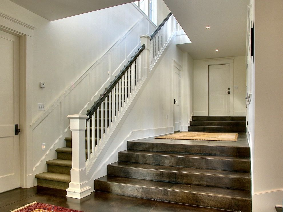 Concrete Staining Oc with Traditional Staircase  and Carpeted Stairs Dark Stained Banister Oriental Rug Stained Concrete Wainscot White Painted Wood