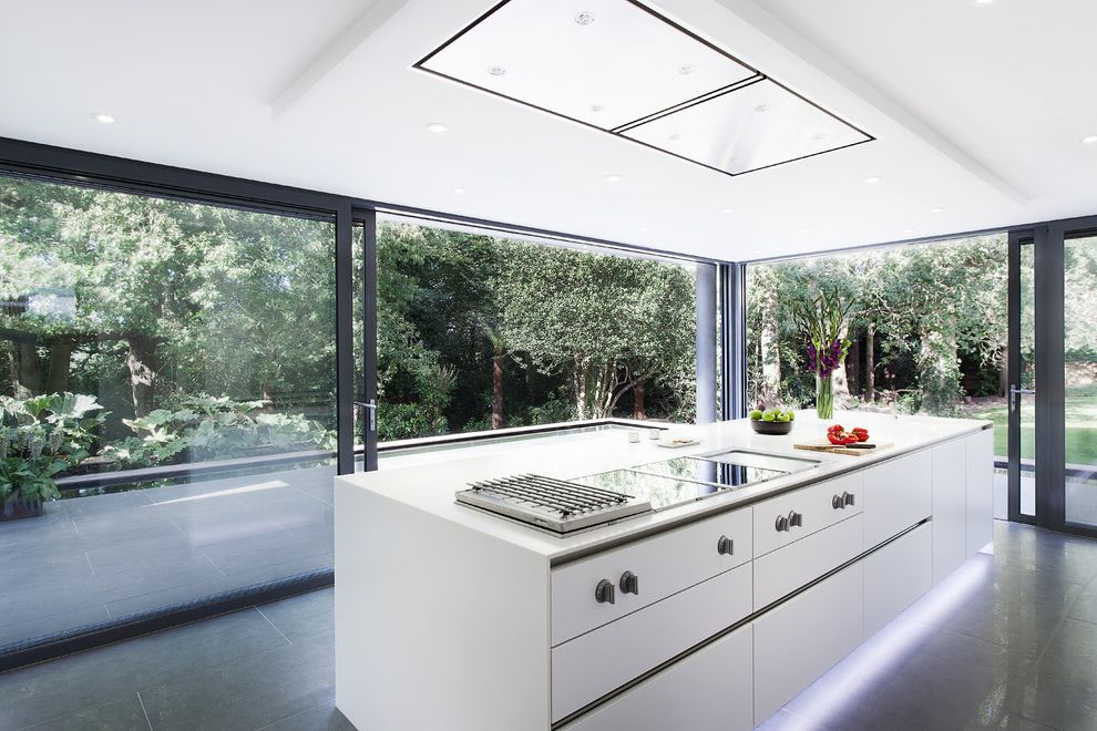 Conduction Stove   Modern Kitchen Also Cooktop Floor to Ceiling Windows Oversized Sliding Glass Door Recessed Ceiling Under Cabinet Lighting White Cabinets White Ceiling White Countertop White Kitchen Island Window Wall
