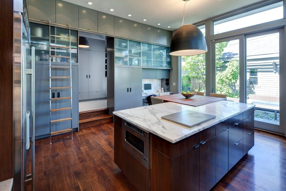 Construction Companies in Phoenix   Contemporary Kitchen Also Aluminum Windows Butcher Block Dark Stained Wood Gray Cabinets Kitchen Island Ladder Pendant Light Recessed Lights Translucent Glass Transom Window Window Wall Wood Floor