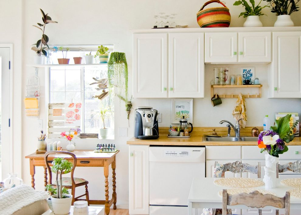 Consumer Reports Kitchen Appliances with Farmhouse Kitchen Also Basket Butcher Block Cup Rack Eclectic Kitchen Flowers Green Knobs Mug Plant Pots Raised Panel Cabinets Turned Legs Vase White Appliances White Cabinetry White Table Window Shelf