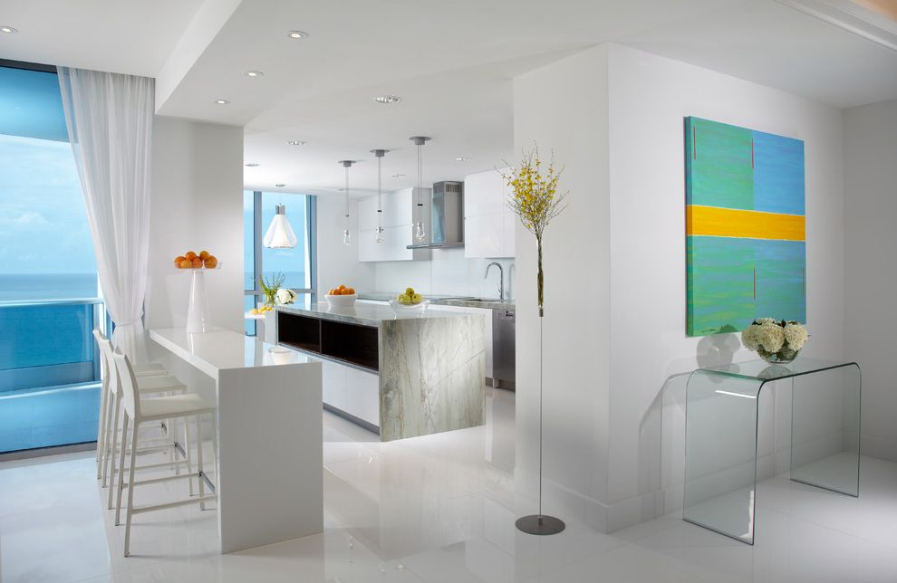 Contemporary Family Services with Contemporary Kitchen Also Acrylic Console Table Beach Counter Stools Kitchen Island Miami Pendant Lighting Sheer White Curtain Wall Art Water View White Counter White Floor White Kitchen