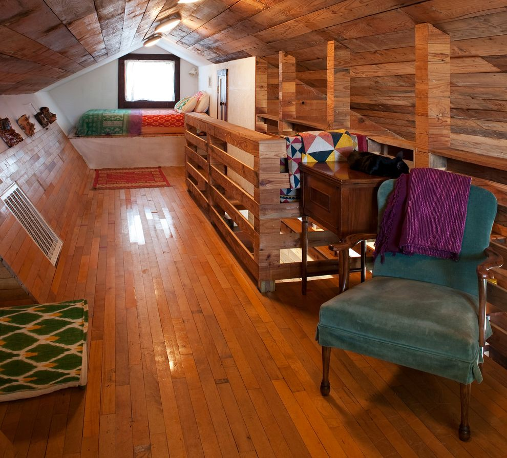 Convert Attic to Loft with Eclectic Bedroom  and Angled Wall Attic Bedroom Bedroom Built in Cabin Contemporary Loft Quilt Railing Teal Chair Vintage Furniture Weatherd Wood Window Seat Window Trim Wood Ceiling Wood Flooring Wrap