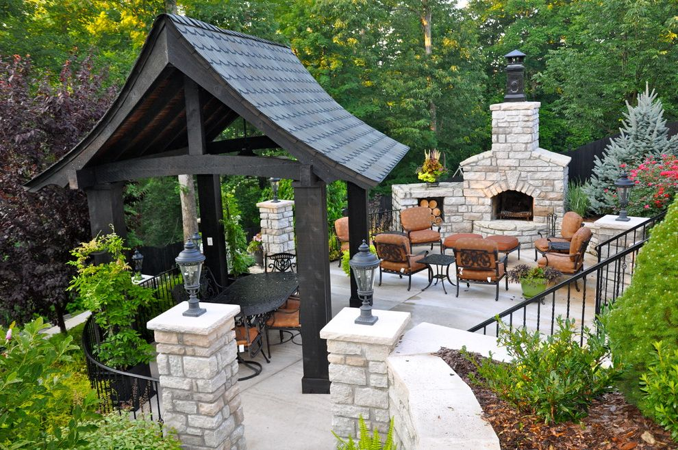 Cooper Electric Cincinnati with Traditional Patio  and Landscaping Lanterns Metal Railing Outdoor Dining Outdoor Entertaining Outdoor Fireplace Outdoor Seating Outdoor Structure Pavilion Seat Cushions Shingle Roof Timber Frame Wood Chips