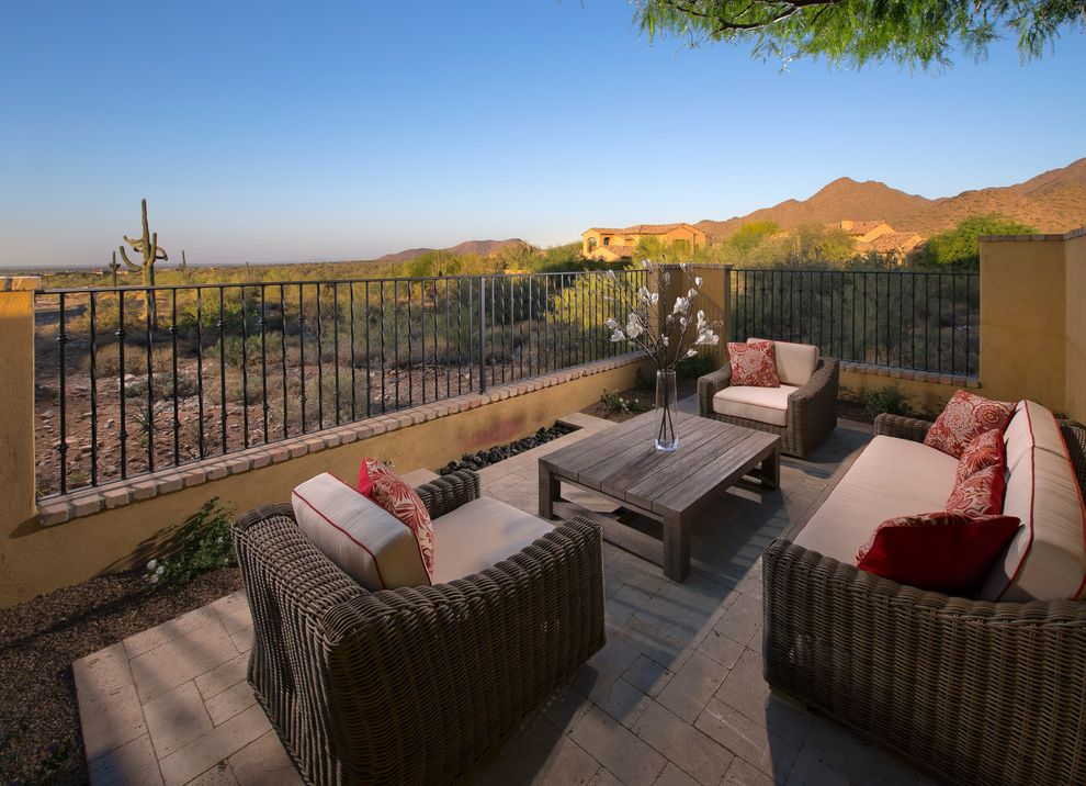 Copenhagen Furniture Scottsdale with Transitional Patio  and Desert Landscape Outdoor Living Space Outdoor Patio Furniture Outdoor Seating Paved Patio Red and White Pillows Twisted Railing Wicker Patio Furniture Wood Coffee Table Wrought Iron Railing