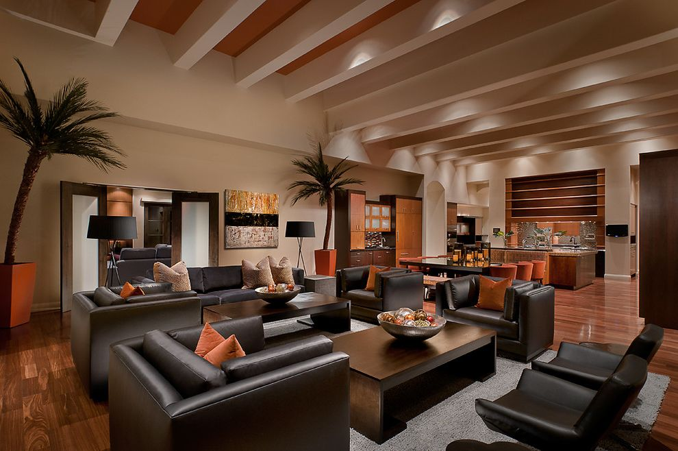 Copenhagen Furniture Scottsdale with Tropical Family Room Also Accent Ceiling Accent Color Art Coffee Table Floor Lamp Leather Chair Leather Sofa Orange Plants Rug Traditional Wood Floor