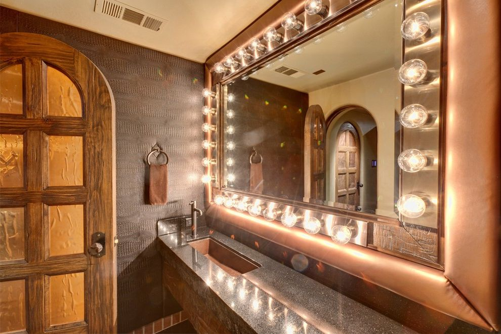 Copper Creek Theater   Mediterranean Bathroom  and Arched Doorway Bar Marquee Media Room Theater Theater Bathroom Theater Lights Theater Restroom Trough Sink Upholstered Mirror Frame Wallpaper Wood Door