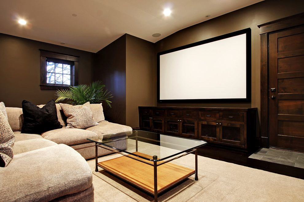 Copper Creek Theater with Contemporary Home Theater Also Area Rug Brown Dark Wall Color Frame and Panel Door Glass Coffee Table Pillows Projection Screen Recessed Ligths Sofa Tile Entry Wood Floor