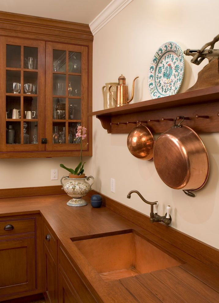 Copper Sink Reviews   Traditional Kitchen  and Brass Butler Pantry Cherry Cabinets Copper Pots Copper Sink Cup Pulls Dark Stained Wood Dowel Hooks Glass Front Cabinets Pot Rack Pottery Wall Mount Faucet Wood Counters