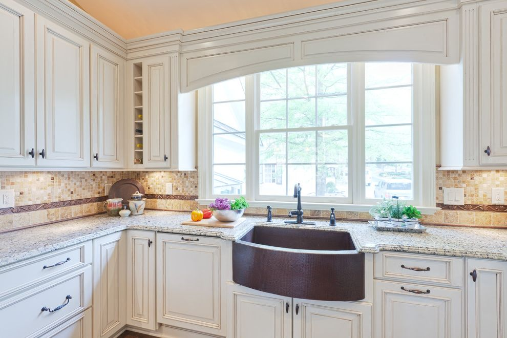 Copper Sink Reviews with Traditional Kitchen Also Beverage Cooler Black Painted Custom Hood Frame and Panel Glass Panel Cabinets Pendant Lights Raised Panel Stainless Steel Tile Backsplash White Painted Cabinets Wine Storage Wood Floor