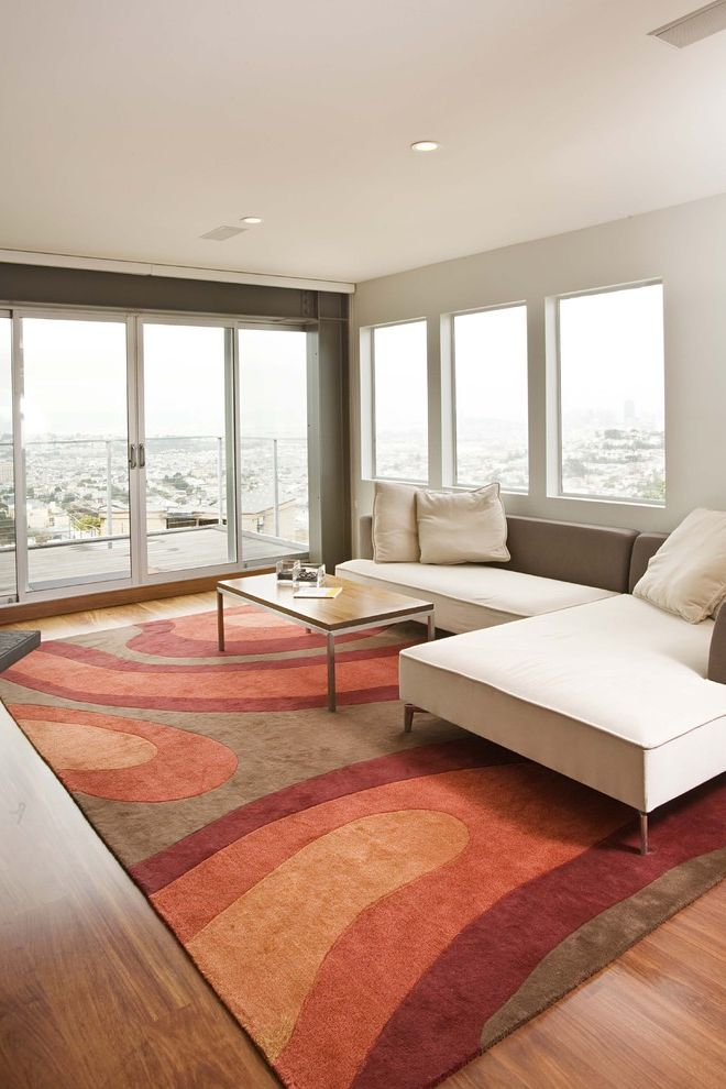 Coral Colored Area Rugs with Contemporary Family Room Also Area Rug Balcony Corner Sofa Glass Doors Minimal Neutral Colors Sectional Sofa Sliding Doors Technicolor Rug View Wood Flooring