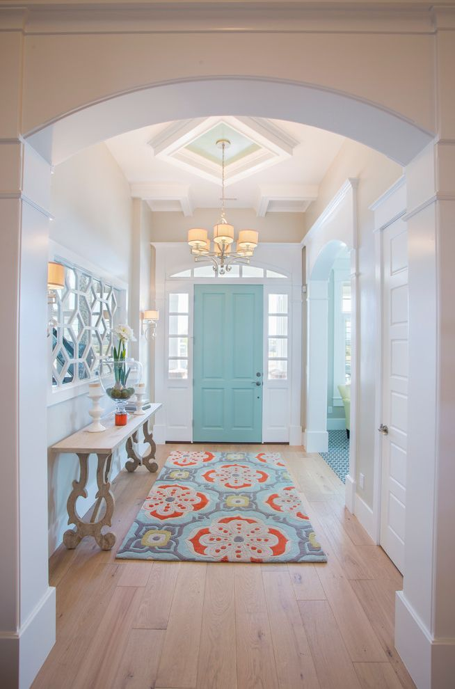 Coral Colored Area Rugs with Transitional Entry  and Arched Doorway Chandelier Colorful Area Rug Console Table Decorative Mirror Traditional Design Turquoise Turquoise Door
