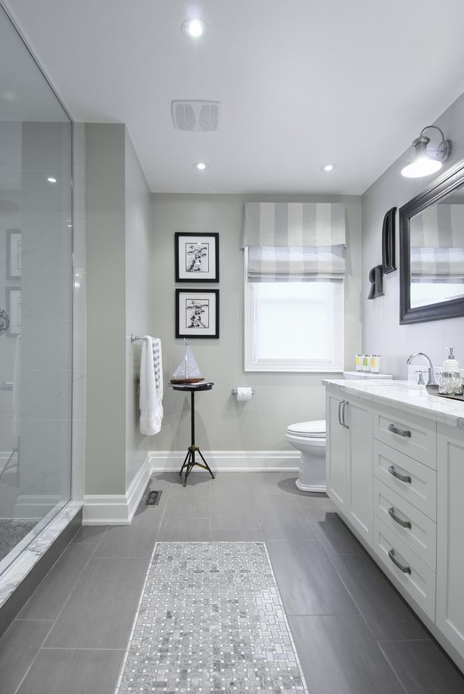 Coretec Flooring Reviews with Traditional Bathroom  and Framed Mirror Gray Floor Tile Striped Roman Shade White Countertop