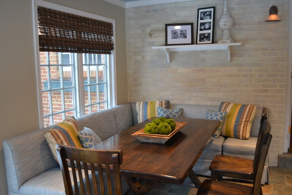 Corner Banquette Seating for Sale with Traditional Dining Room Also Bamboo Shades Banquette Blue Blue Ceiling Breakfast Room Brick Wall Eating Area Fretwork Ikat Photos Roman Shade Shelf Stripes Sunroom Trestle Table Whitewashed Brick Wall X Table