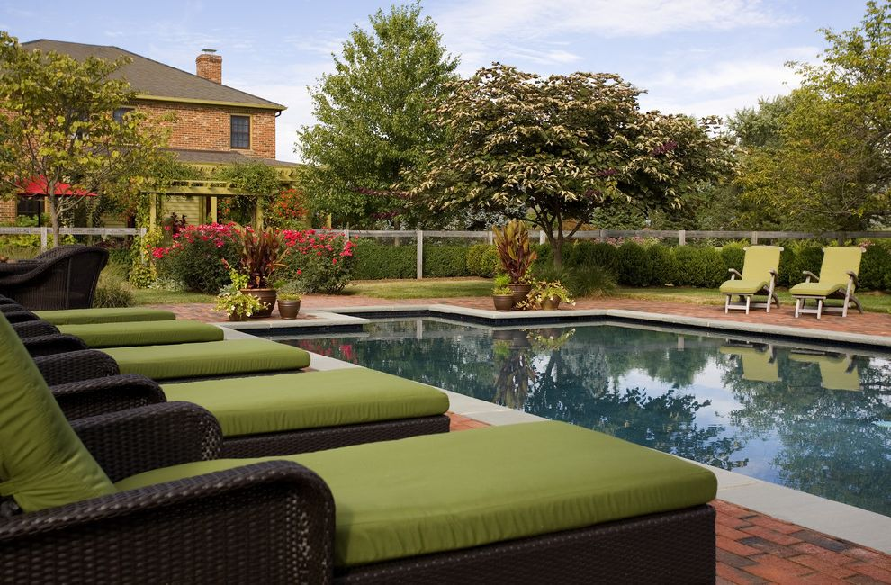Corner Fence Landscaping    Spaces  and Brick Pool Deck Chimney Garden Fence Green Seat Cushions Landscape Landscape Architecture Landscaping Lifestyle Outdoor Cushions Patio Furniture Plant Pots Pool Pool Deck Reflecting Pool Swimming Pool Woven Lounger