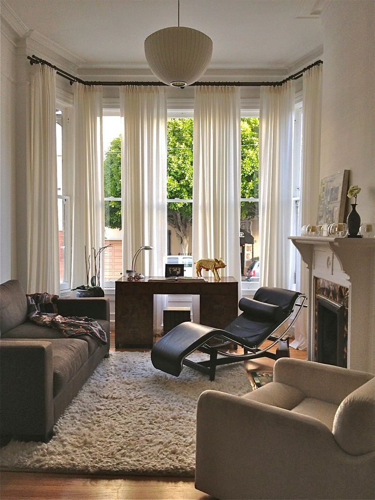 Corner Window Curtain Rod   Eclectic Living Room Also Black Leather Lounge Chair Contemporary Desk Drapery Gold Pig Statue Gray Sofa High Pile Rug Medium Pendant Light Task Lamp White Curtains White Drapes White Fireplace Mantel