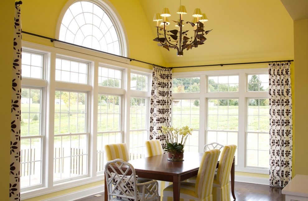 Corner Window Curtain Rod   Traditional Dining Room  and Crown Molding Dining Chairs Dining Table Large Windows Pendant Lighting Upholstered Chairs White Baseboards Window Shades Wood Floors Yellow