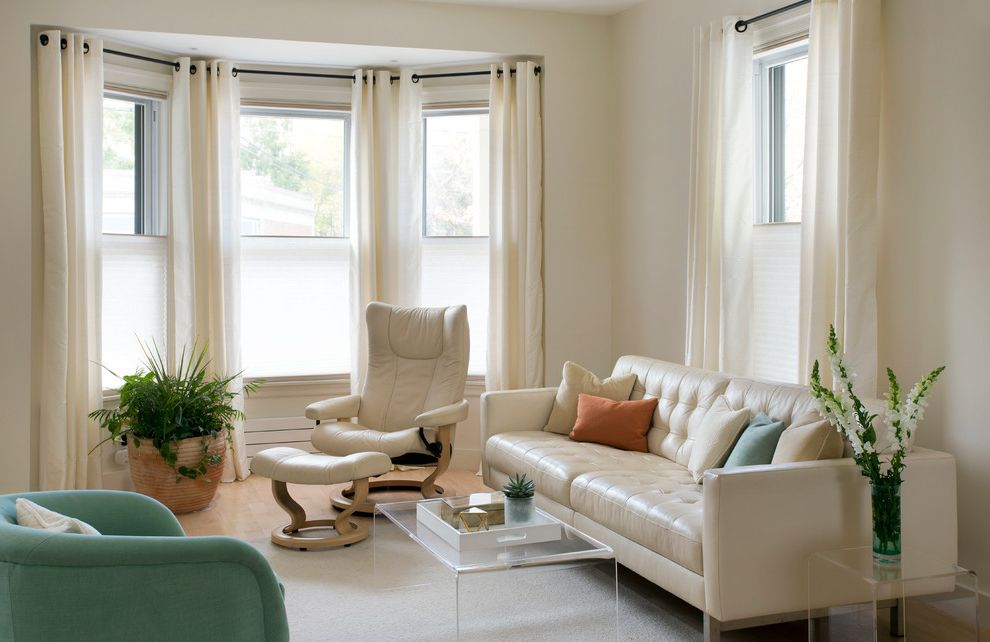 Corner Window Curtain Rod   Transitional Family Room Also Bay Window Clear Acrylic Coffee Table Clear Coffee Table Open Spaces Runtal Radiator Small Space Design Small Spaces Design Swivel Chair Tv Room White Curtains White Furniture White Leather Couch