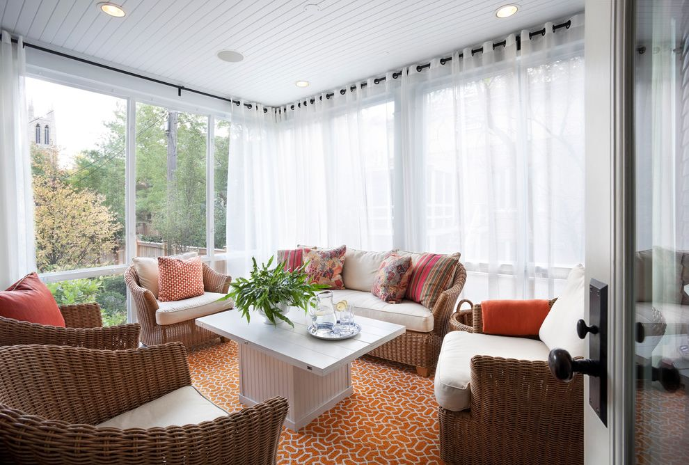 Corner Window Curtain Rod   Transitional Sunroom Also Glass Wall Orange Rug Recessed Lighting Sun Porch Sun Room Throw Pillow White Curtains White Sheers Wicker Furniture Wood Coffee Table