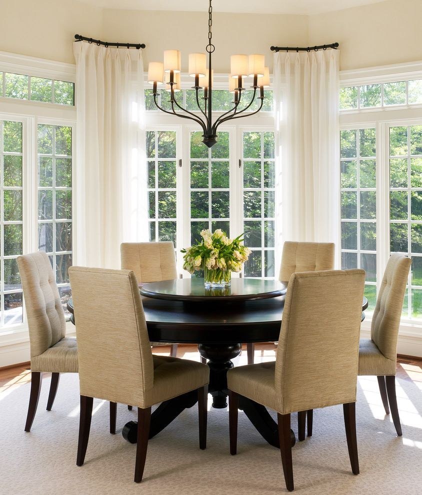 Corner Window Curtain Rod with Transitional Dining Room  and Bay Breakfast Room Champagne Drapes French Doors Iron Chandelier Lazy Susan Pedestal Table Round Dining Table Transom Tufted Upholstered Dining Chairs White Sheers Wood Dining Table