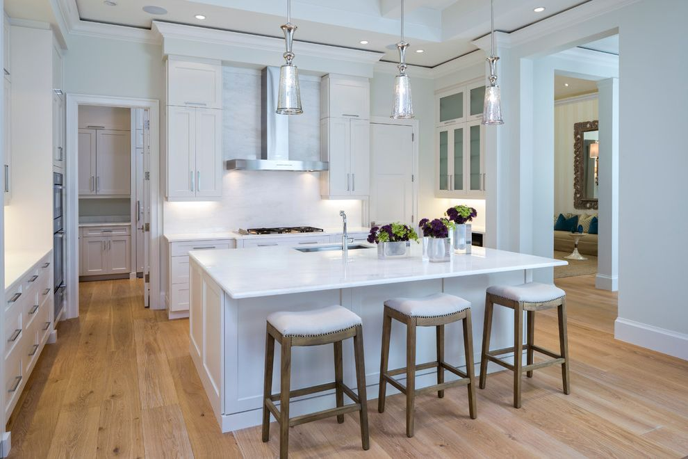 Cortex Plus Flooring   Transitional Kitchen  and Beamed Ceiling Engineered Wood Flooring Pendant Light Undercabinet Lighting White Countertop White Kitchen Wide Plank Flooring Wood Floor in Kitchen