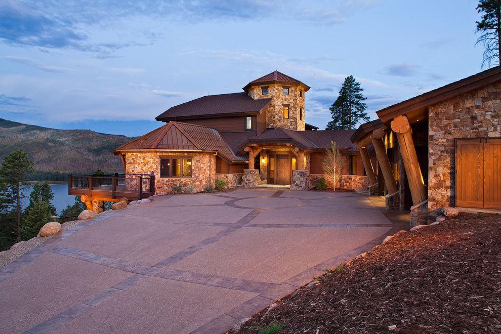 Cost to Replace Concrete Driveway   Contemporary Exterior Also Cabin Deck Driveway Front Door Lodge Metal Roof Mulch Night Stone Facade Stone Faced Stone House Stone Wall Tree Trunks Waterfront