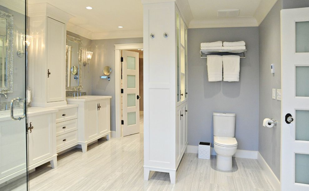 Costco One Piece Toilet with Traditional Bathroom  and 4 Panel Doors Cabinet Decorative Mirror Double Sinks Frosted Glass Glass Door Knobs Light Gray Walls Private Area Tile Floor Train Rack White Cabinets White Counters