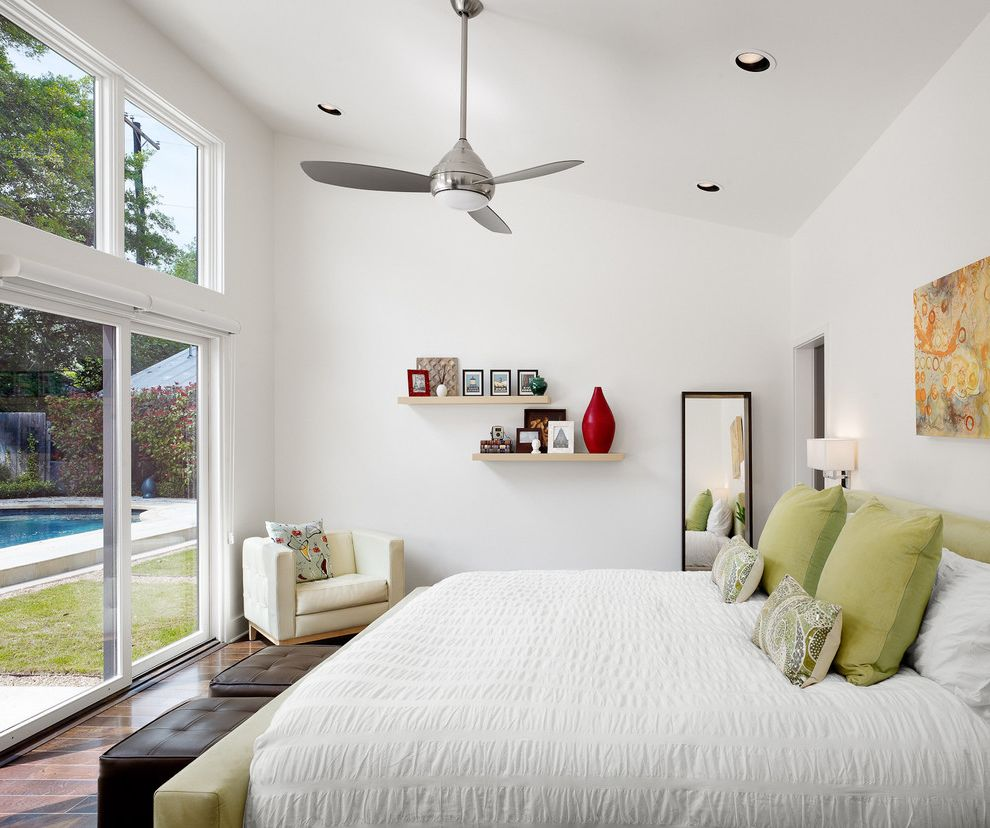 Cottage Style Ceiling Fans   Contemporary Bedroom  and Ceiling Fan Dark Brown Ottoman Dark Wood Floor Floor Mirror Green Accent Pillows Green Bed Large Windows Leather Ottoman Sliding Glass Door Wall Shelves White Armchair White Bedding White Wall