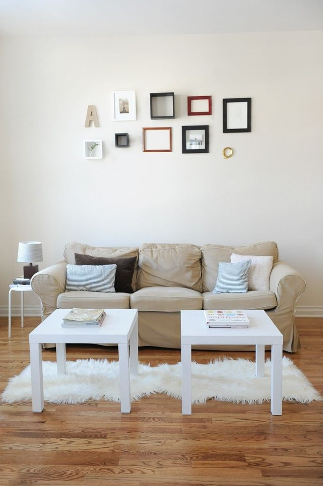 Couch Table Ikea with Eclectic Living Room  and Decorative Pillows Gallery Wall Neutral Colors Sheepskin Rug Slipcovers Throw Pillows Wall Art Wall Decor Wood Flooring