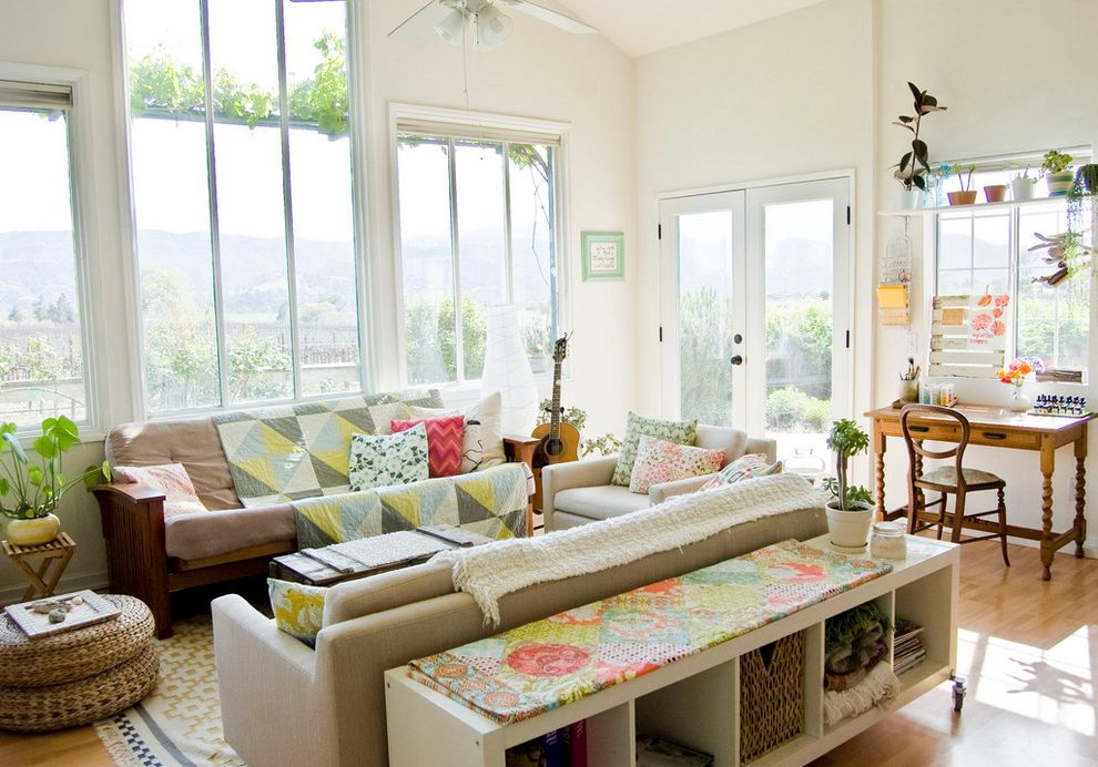 Couch Table Ikea with Farmhouse Living Room  and Antique Bohemian Bright and Airy Ceiling Fans Colorful Cubbies Desk French Doors Guitar Indoor Plants Quilt Sofa Tall Windows Vineyard Warm Eclectic Warm Modern Window Shelf Wood Floor