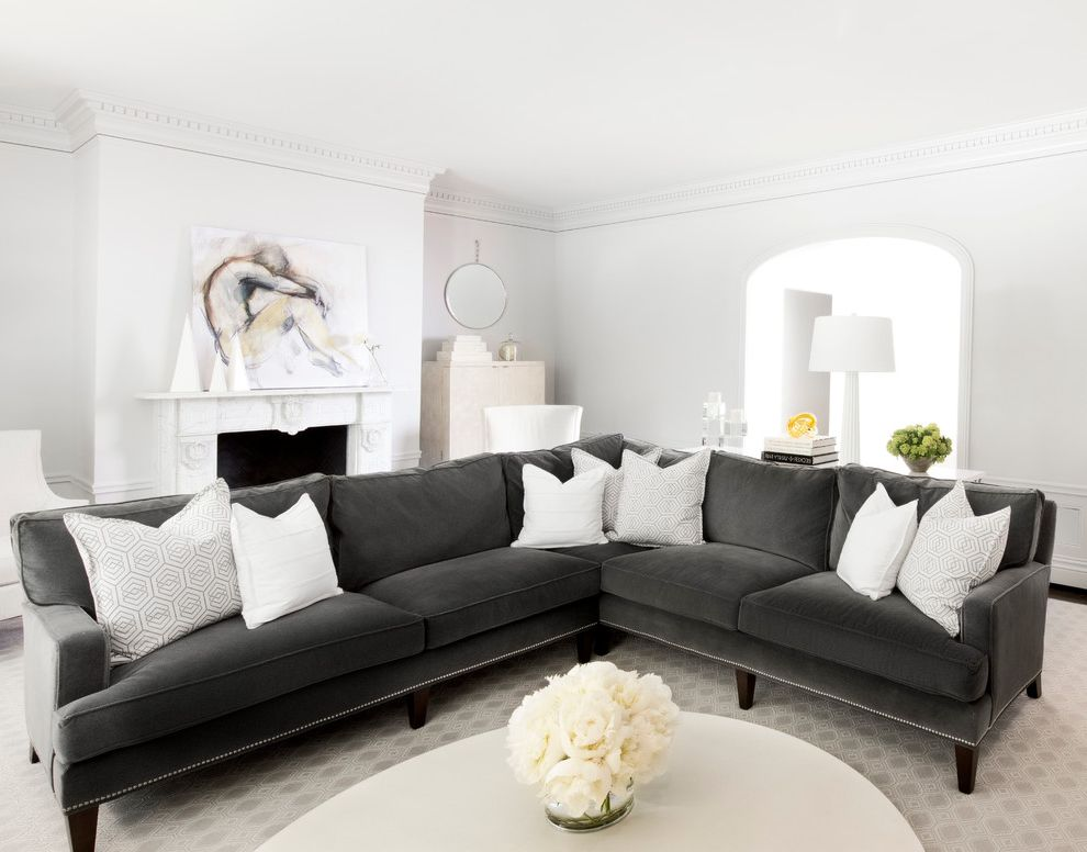 Couch with Studs   Transitional Living Room  and Bold Classic Clean Contemporary Art Dark Gray Couch Eclectic Gray and White Gray Rug Historic Modern Serene Sophisticated Transitional White Pillows