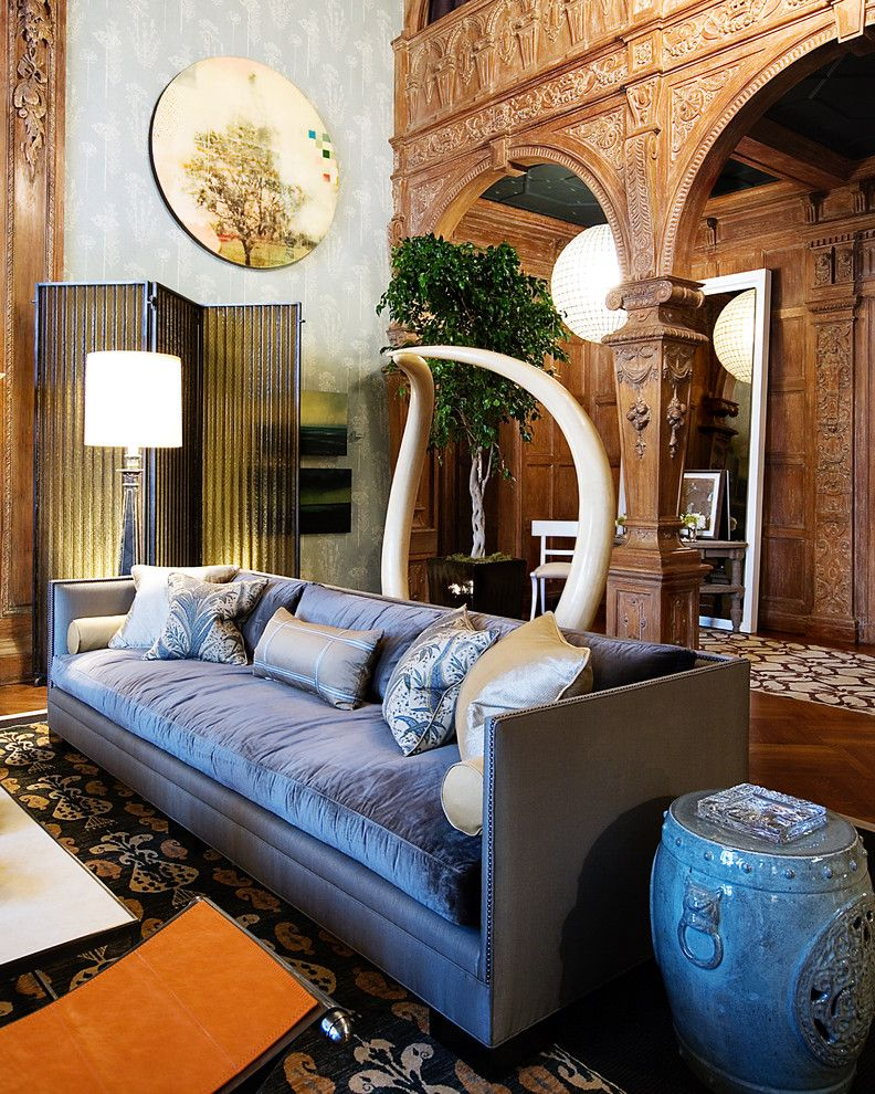 Couch with Studs with Eclectic Living Room  and Art Asian Blue Sofa Ceiling Light Color Divider Floor Lamp Mirror Rug Urn Wood Floor Wood Work