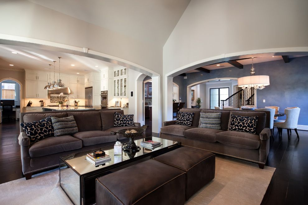 Couch with Studs with Traditional Living Room Also Dark Gray Ottoman Dark Gray Sofa Dining Room Drum Shade Chandelier Gray Area Rug Gray Sofa Gray Walls Great Room Kitchen Mirrored Coffee Table Wide Arches Wide Archways