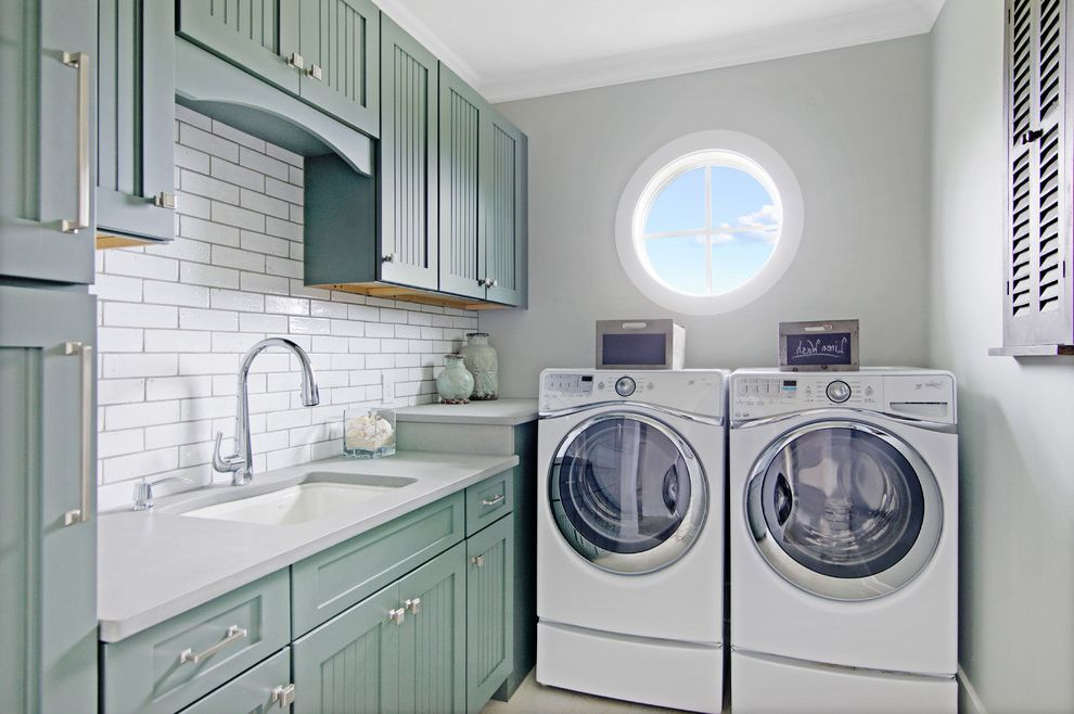 Countertops Jacksonville Fl with Beach Style Laundry Room  and Dedicated Laundry Room Gray Countertops Green Cabinets Round Window Side by Side Washer Dryer Silver Fixtures Sink Small Spaces Subway Tile Tongue in Groove Cabinets