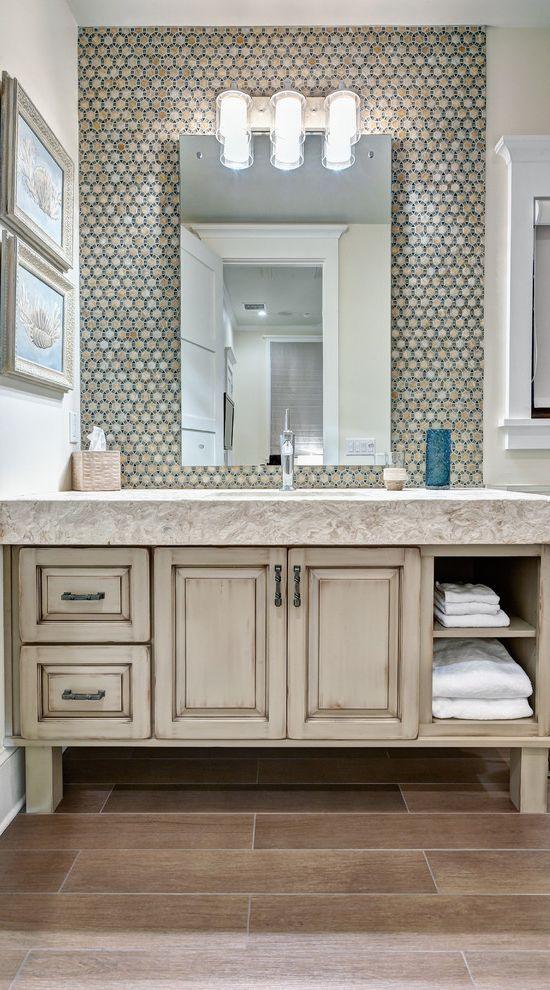 Countertops Jacksonville Fl with Tropical Bathroom  and Bathroom Backsplash Bathroom Storage Bathroom Wall Sconce Distressed Cabinet Distressed Vanity Stone Countertop Tile Floor Towel Storage