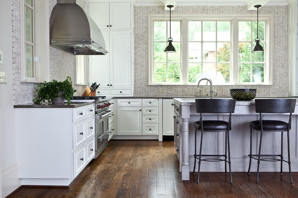 Cramers Kids with Traditional Kitchen  and Black Counter Stool Black Countertop Gray Tile Backsplash Industrial Pendant Light Light Wood Kitchen Island Pendant Light Range Hood White Cabinets White Drawers Wood Floor
