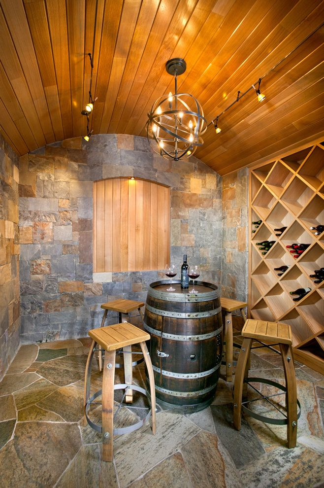 Crate and Barrel Denver with Mediterranean Wine Cellar Also Bar Table Built in Wine Storage Cage Chandelier Ceiling Lighting Flagstone Pavers Stone Wall Tasting Room Track Lighting Vaulted Ceiling Wine Barrel Table Wine Racks Wood Ceiling