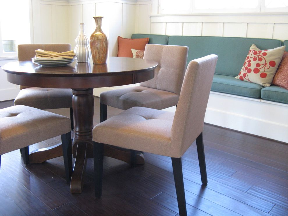 Crate and Barrel Furniture Coupon   Eclectic Dining Room  and Bench Seat Board and Batten Siding Dark Stained Wood Engineered Floor Round Dining Table Seat Cushions Upholstered Chairs Wood Floor