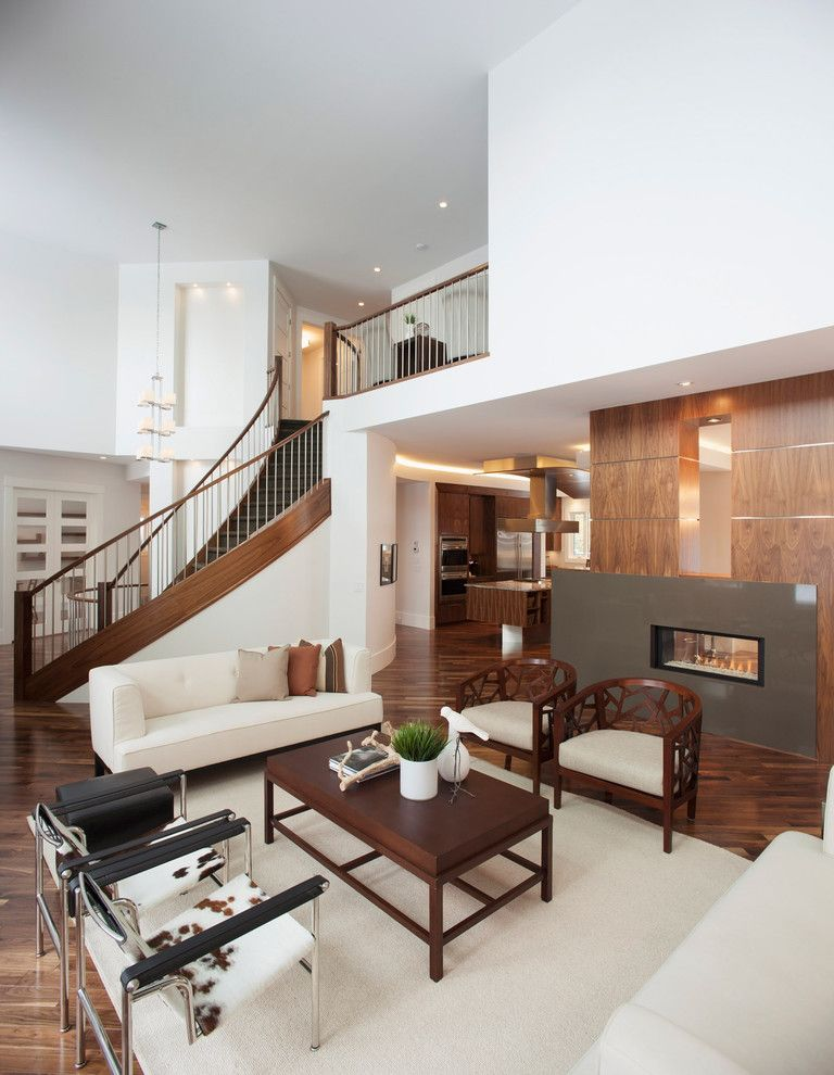 Crate and Barrel Furniture Coupon with Contemporary Living Room Also 20 Foot Ceilings Area Rug Cowhide Dark Stained Wood Fireplace Fretwork Modern Furniture Seating Area Sling Chair Walnut Spiral Staircase White Upholstery Wood Floor Wood Paneling