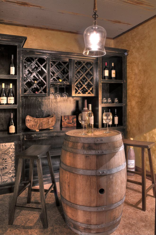 Crate and Barrel Two with Rustic Wine Cellar  and Glassware Metal Ceiling Pendant Light Tasting Room Wine Barrel Table Wood Stools